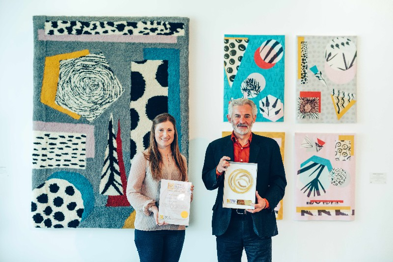 Hannah-Harris-Director-of-Development-and-Professor-Andrew-Brewerton-Principal-and-Chief-Executive-of-Plymouth-College-of-Art-with-the-Social-Enterprise-Gold-Mark-award