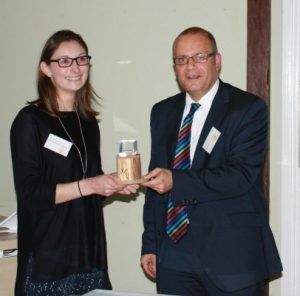 Becky Casement of ECT accepting the Making a Mark competition award from James Evans