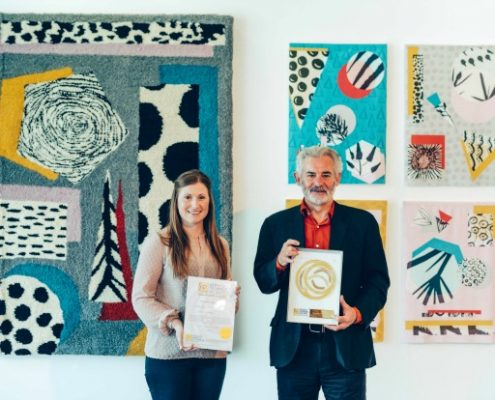 Hannah Harris, Director of Development, and Professor Andrew Brewerton, Principal and Chief Executive of Plymouth College of Art, with the Social Enterprise Gold Mark award