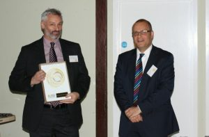 Nick Petford, Vice Chancellor of The University of Northampton receiving the Social Enterprise Gold Mark from James Evans