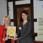 Professor Joy Carter of University of Winchester receiving Social Enterprise Gold Mark from Lucy Findlay
