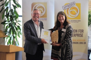 Phil Hope presenting Louise van Rhyn of Partners for Possibility with Making a Mark competition award