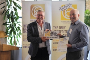 Phil Hope presenting Chris Deacy of Cardiff Metropolitan University with the Social Enterprise Mark