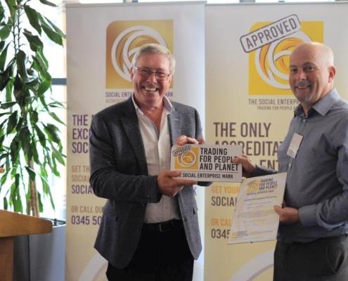 Phil Hope presenting Chris Deacy of Cardiff Metropolitan University with the Social Enterprise Mark