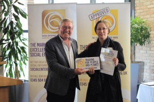 Phil Hope presenting Danielle Bacon of Investors in People with the Social Enterprise Mark