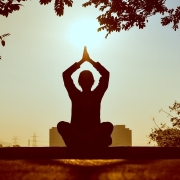 Person in suit doing yoga pose