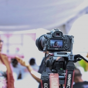Lady being interviewed in front of camera
