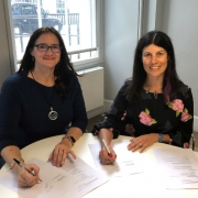 Lucy Findlay and Rebecca Dray signing Social Enterprise Mark franchise agreement