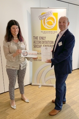 Lucy Findlay presenting Nigel Lewis of CLARITY with the Social Enterprise Disability Employment Mark