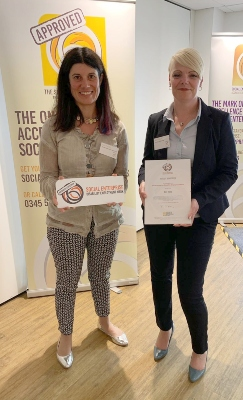 Lucy Findlay presenting Sam Peplow of Yateley Industries with the Social Enterprise Disability Employment Mark