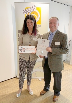 Lucy Findlay presenting Steve Hawkins of Pluss with the Social Enterprise Disability Employment Mark