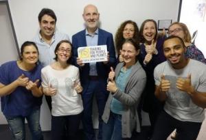FLOCERT staff with Social Enterprise Mark plaque