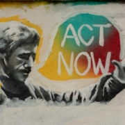 Mural of man saying 'Act Now'