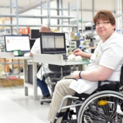 Person in a wheelchair working at a computer