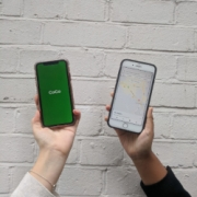 Two hands holding mobile phones showing the CoGo app