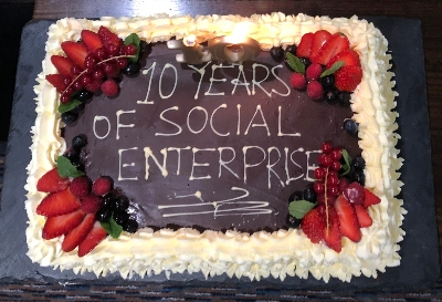 Cake with words 'ten years of social enterprise'
