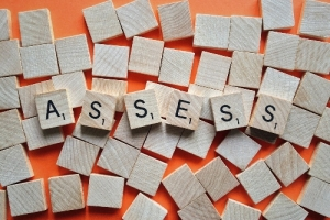 Wooden tiles spelling out 'Assessment'