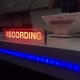 Neon sign in a recording studio that says 'Recording'