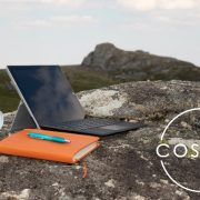 Photo of a laptop and notepad on a rock on the Moors