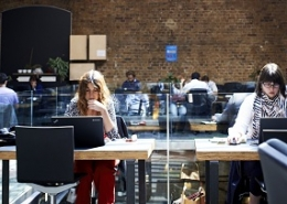 Image of people sat at desks in a co-working space
