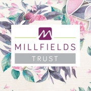 Millfields Trust logo on a floral background