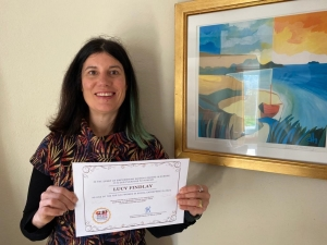 Lucy Findlay with her Euclid Network Top 100 Women in Social Enterprise certificate