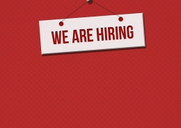 Red background with a white sign saying 'We are hiring'