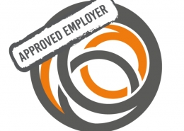 Grey and orange overlapping circles with a stamp across the top left saying 'Approved Employer'